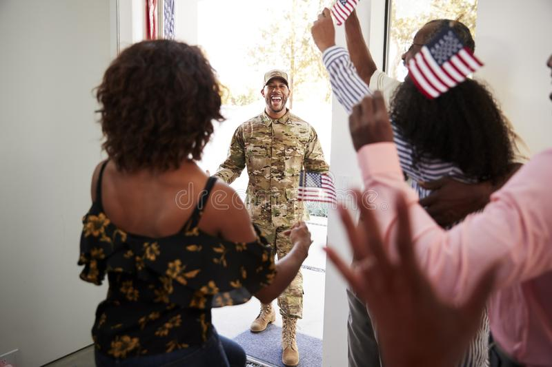 Wife and family waiting by front door for young African American  soldier returning home, close up royalty free stock images