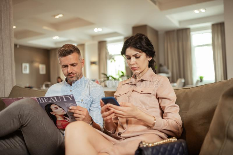 Wife feeling angry at husband not supporting her wish to change nose. Wife feeling angry. Dark-haired wife feeling angry at husband not supporting her wish to stock images