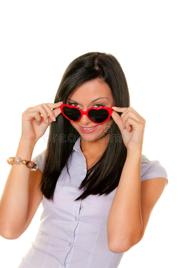 Wife flirts. Young woman with heart-shaped sunglasses stock photography
