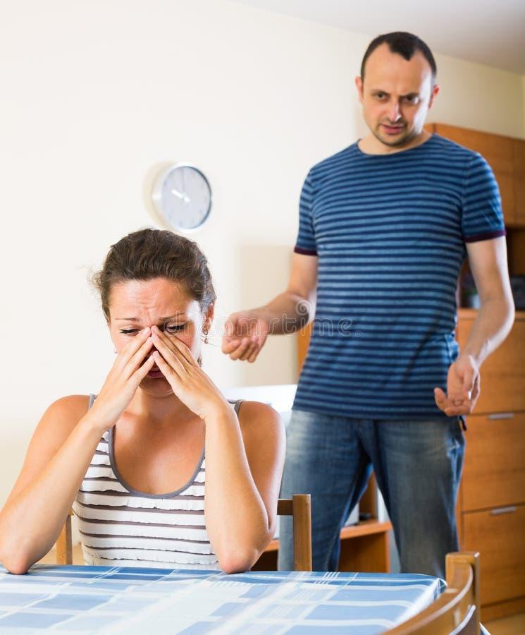 Wife and furious husband discussing divorce. Unhappy american wife and furious husband discussing divorce stock photos