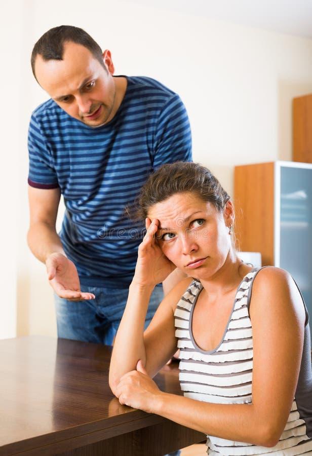 Wife and furious husband discussing divorce. Unhappy russian wife and furious husband discussing divorce stock photos