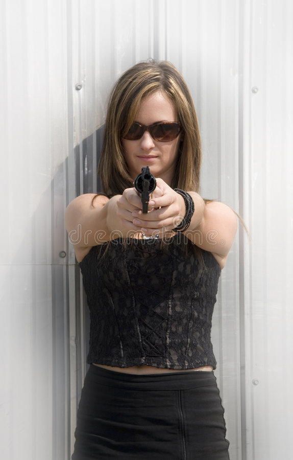 Wife from hell. Attractive woman point gun at viewer royalty free stock photography