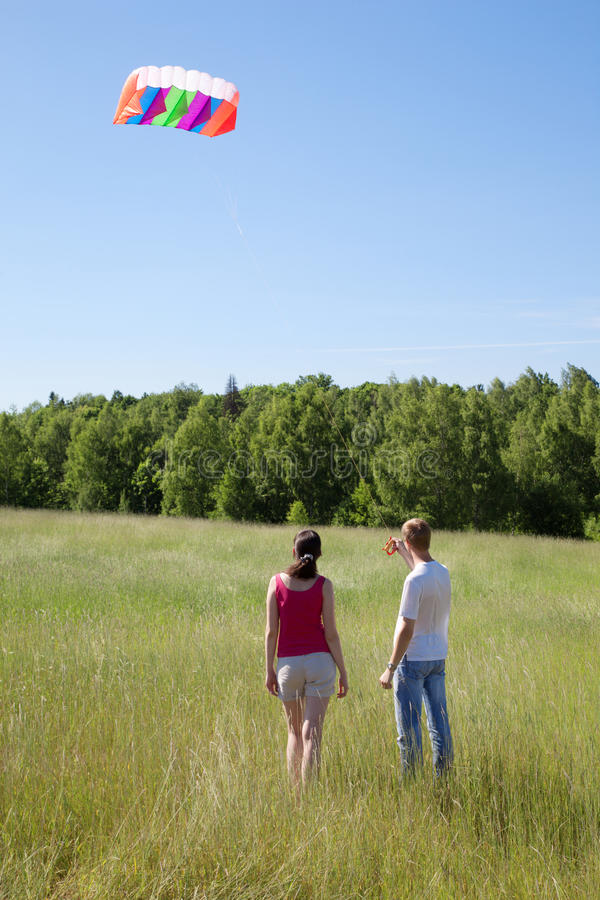 Download Wife, Husband Launch Kite In Field Stock Photo - Image: 27108180