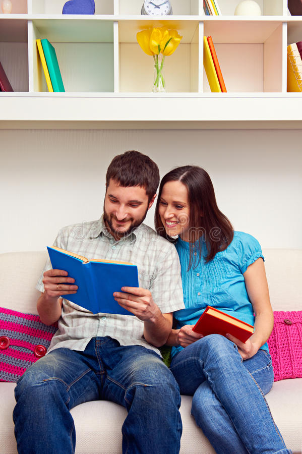 Download Wife And Husband Reading The Book Stock Image - Image of couple, couch: 29731135