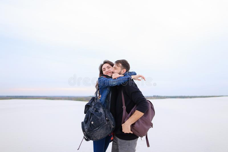 Wife rejoicing at good news from husband at seaside. royalty free stock photos
