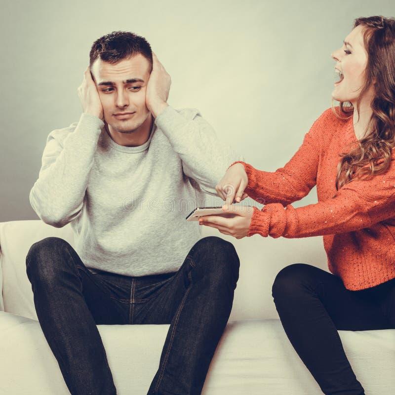 Wife shouting at husband. Cheating man. Betrayal. stock photography