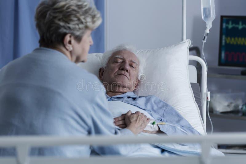 Elder man in coma royalty free stock photo