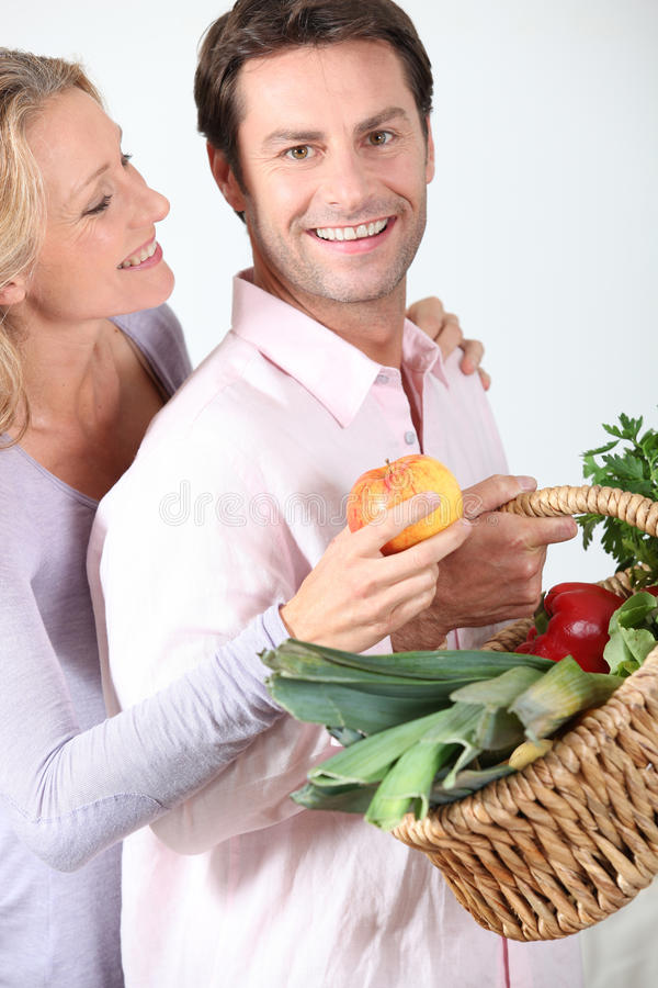 Download Wife Takes Apple From Basket. Stock Image - Image of relationships, healthy: 26505305