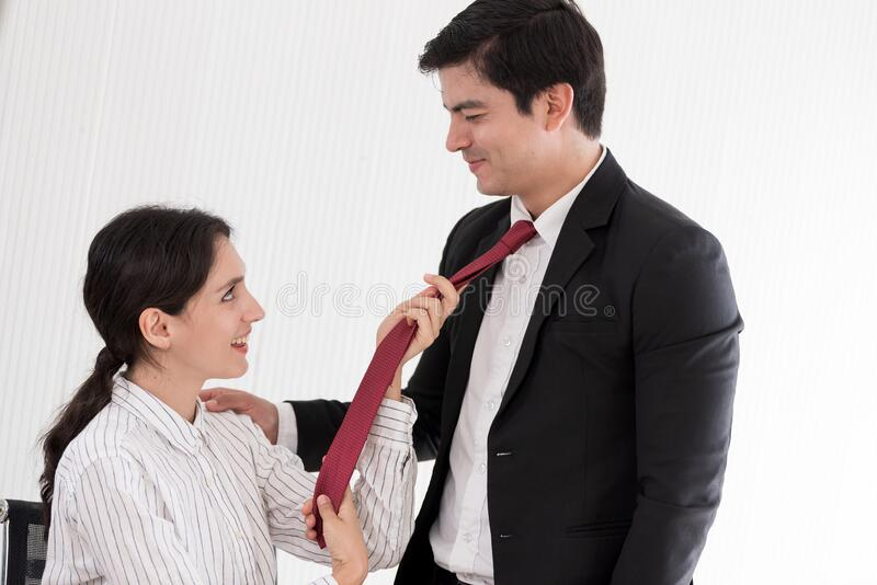 https://thumbs.dreamstime.com/b/wife-tying-red-necktie-to-her-husband-office-smiling-happy-wife-tying-red-necktie-to-her-husband-office-173409884.jpg
