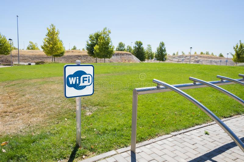 Wifi area signal and bicycle parking in urban park royalty free stock photography