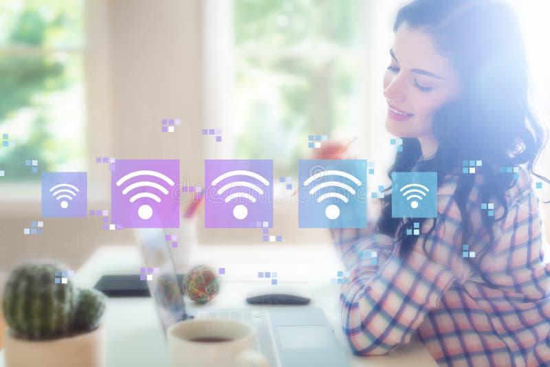 Wifi begrepp med den unga kvinnan royaltyfri bild