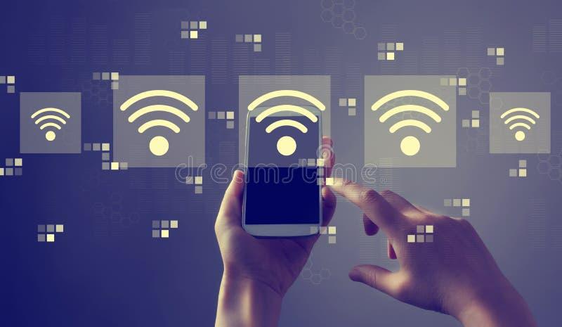 Wifi begrepp med smartphonen royaltyfri foto