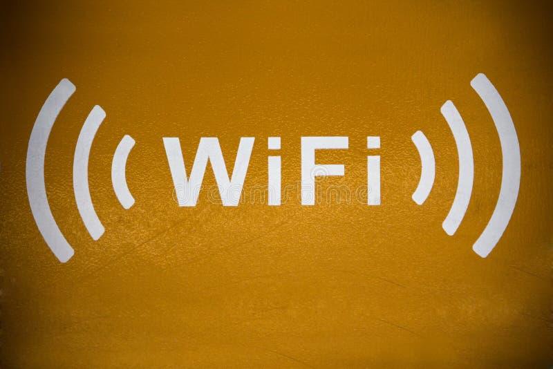 Wifi icon. White wifi icon isolated over orange background stock photography