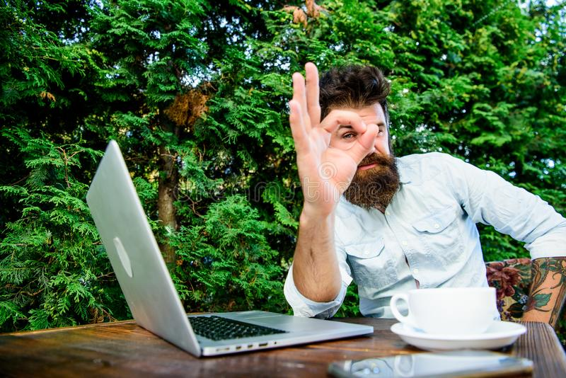 Wifi and laptop. Drink coffee and work faster. Bearded man successful freelance worker. Remote job. Freelance. Professional occupation. Satisfied with result stock photos