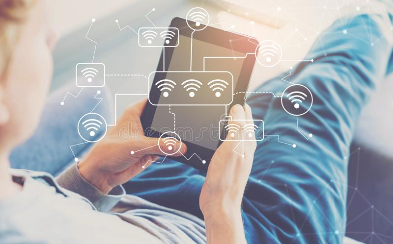 WiFi with man using a tablet royalty free stock photography
