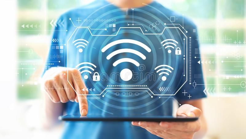 Wifi with man using a tablet royalty free stock photo