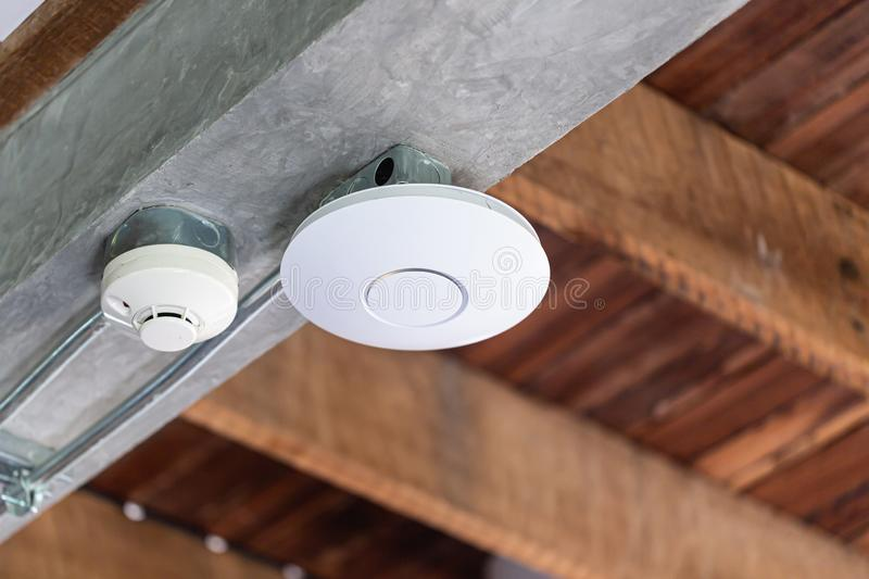 Wifi router or Wireless Access Point Omni type setup at ceiling for Internet connection space. Wifi router or Wireless Access Point Omni type setup at wooden stock photo