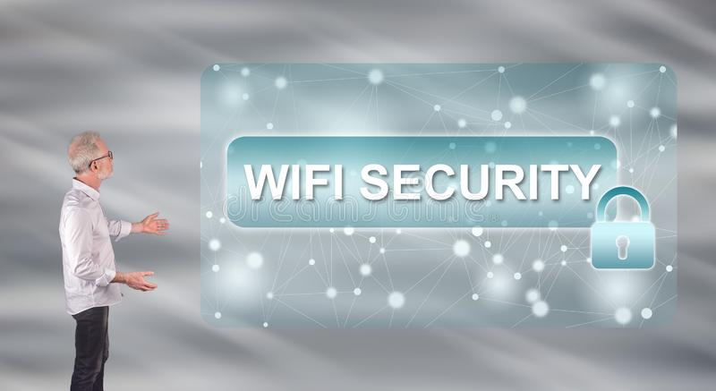 A wifi security concept explained by a businessman on a wall screen. Businessman showing a wifi security concept on a wall screen stock images