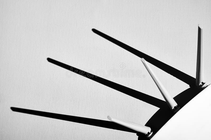 WiFi router technology equipment - Black & White photo. WiFi / Wireless router technology equipment - Black & White photo. Shadows from antenna royalty free stock photos