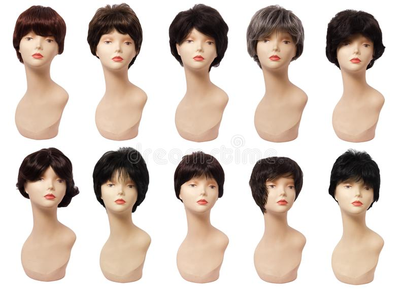 Wig of hair on the mannequin, plastic head. Isolated on white background royalty free stock photo