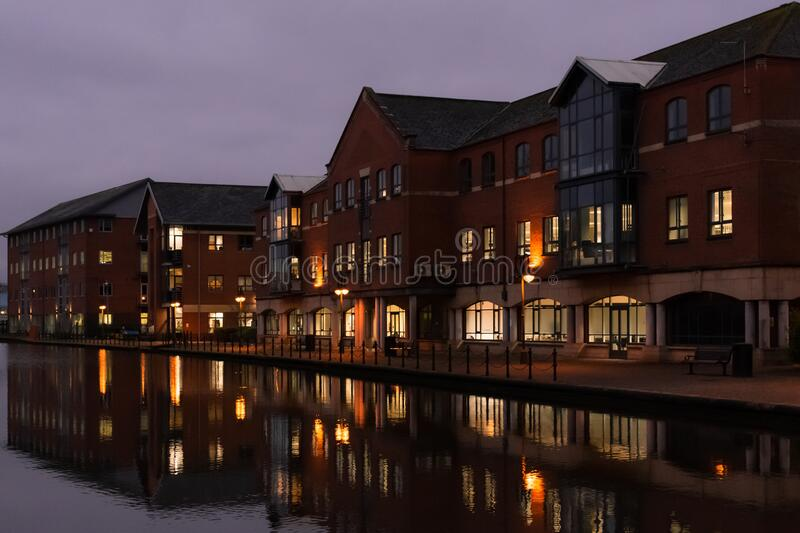 Wigan Canal Offices. Wigan, United Kingdom - January 15 2020: The office buildings along the Leeds-Liverpool Canal in Wigan at twilight stock photos