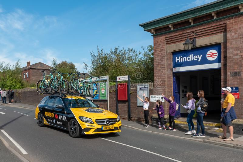 WIGAN, UK 14 SEPTEMBER 2019: A photograph documenting the Team Jumbo-Visma Cycling team support vehicle passing along the route of royalty free stock images