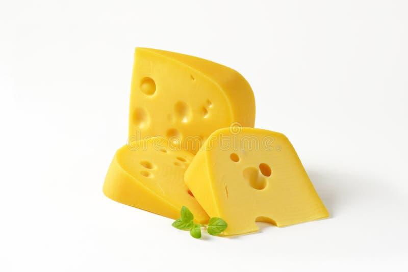 Wiggen van kaas stock afbeelding