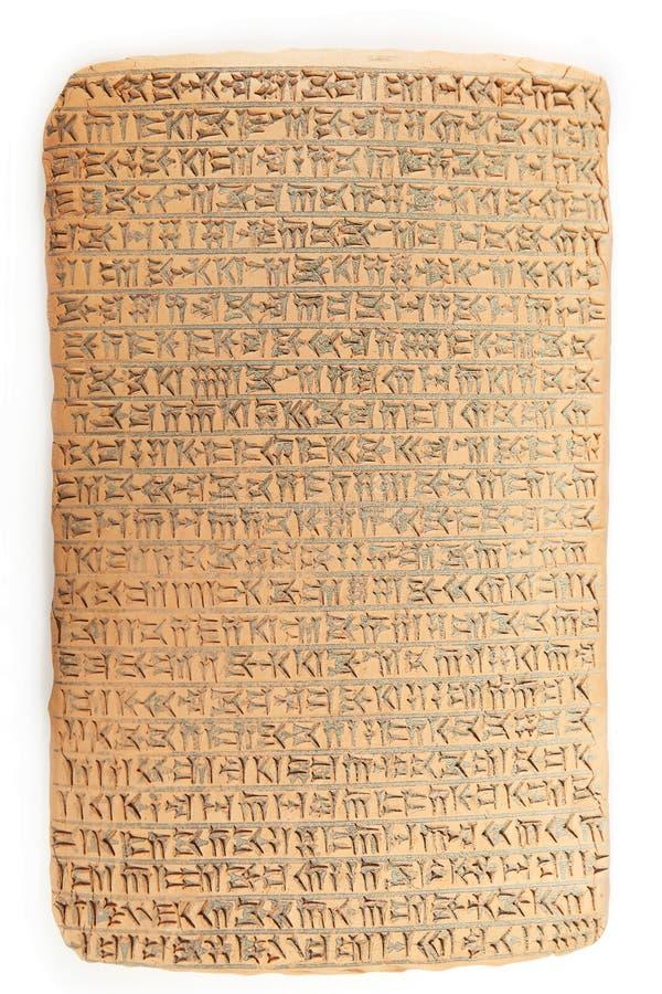 Wigvormig geschreven in bruine klei met rest van zandvuil royalty-vrije stock fotografie