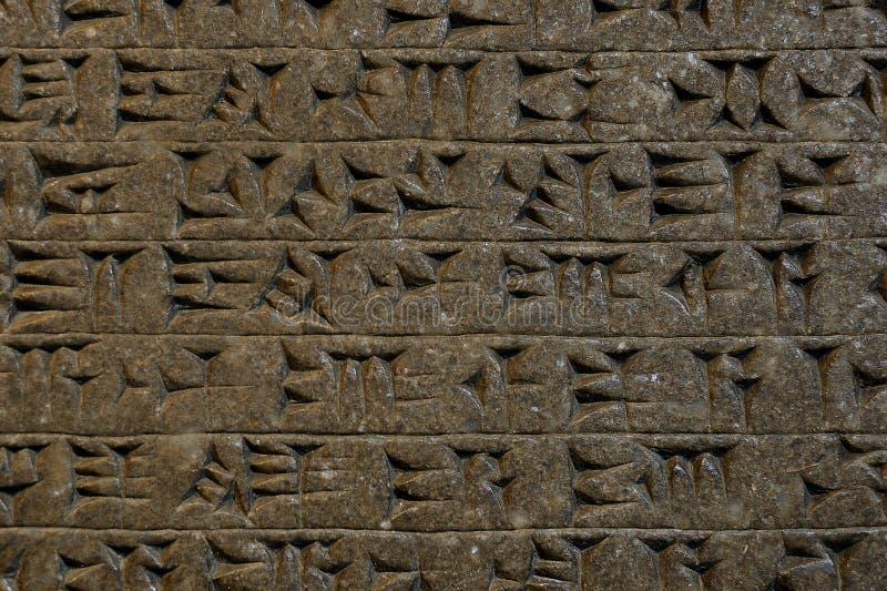 Wigvormige kleitablet die van Mesopotamië schrijven stock foto