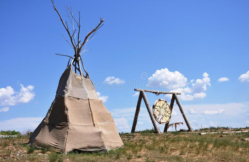Wigwam. And drum on the summer filds royalty free stock photography
