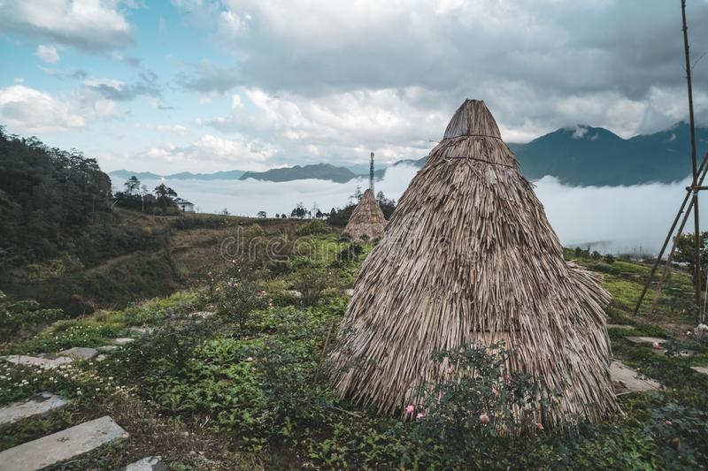 wigwam, an Indian hut from plant stems, against a background of green tropical vegetation, reconstruction. Traditional village. stock image