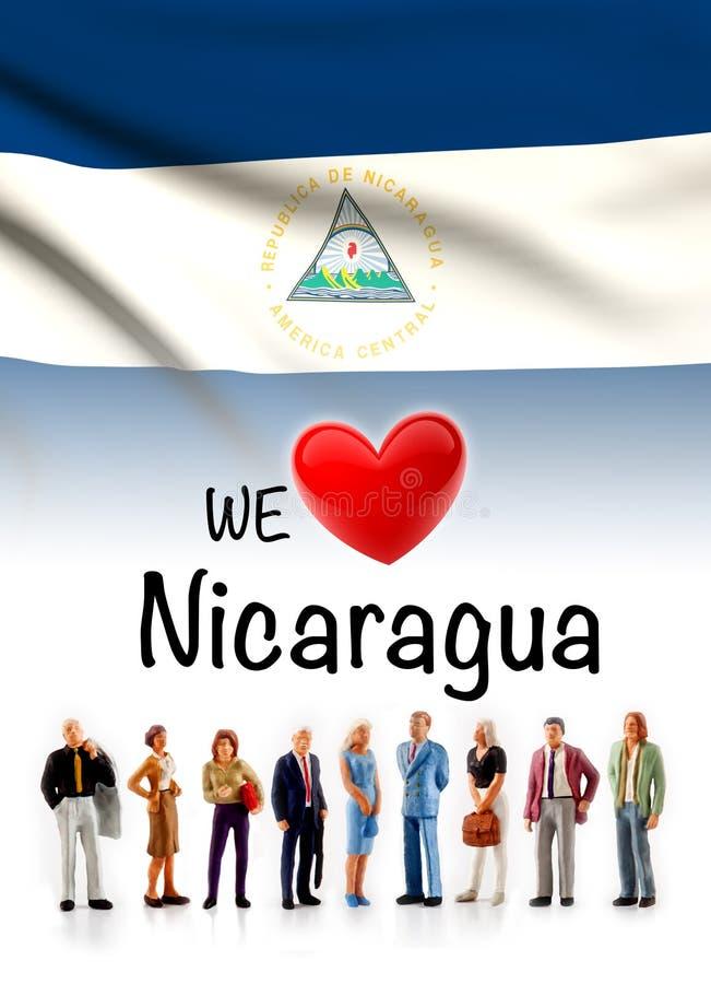 Wij houden van Nicaragua, a-stelt de groep mensen naast de Nicaraguan vlag royalty-vrije stock foto