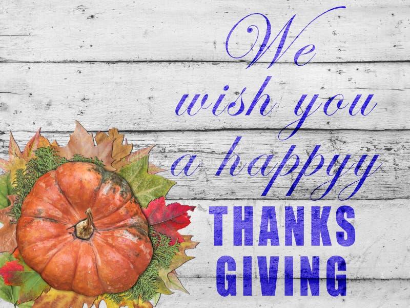 Wij wensen u gelukkige dank die met pompoen en de herfstbladeren geven stock foto