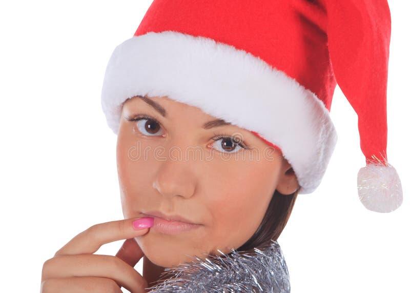 Wijfje in de hoed van de Kerstman over wit stock afbeelding
