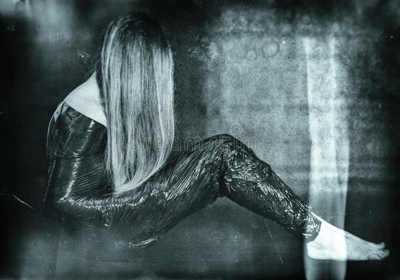 Wijfje in folie - harde depressie royalty-vrije stock fotografie