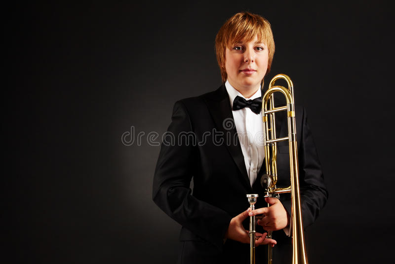 Wijfje met trombone royalty-vrije stock foto