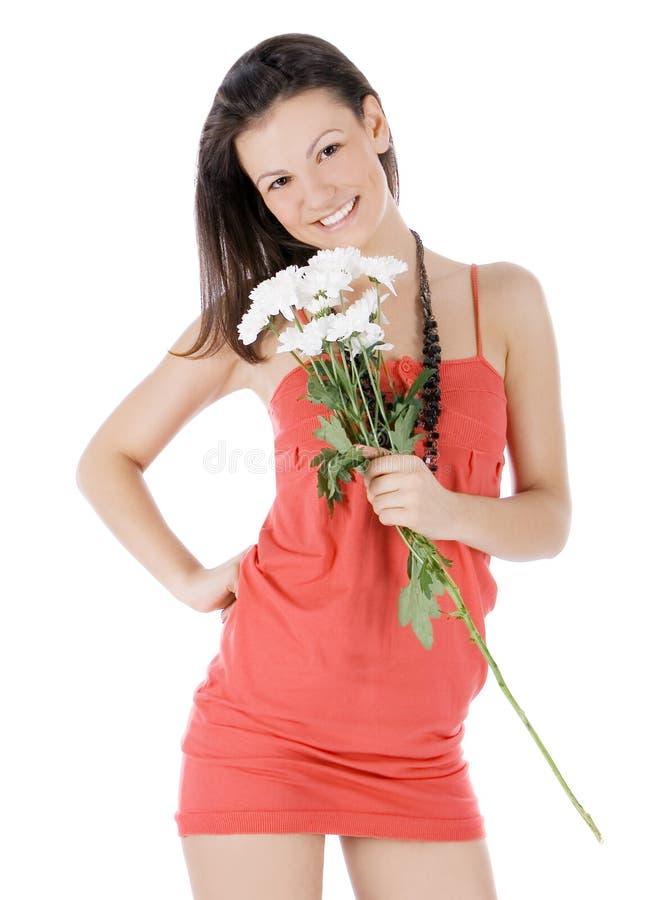 Wijfje in rode kleding met bloemen royalty-vrije stock afbeeldingen