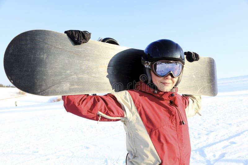 Wijfje snowboarder royalty-vrije stock afbeeldingen