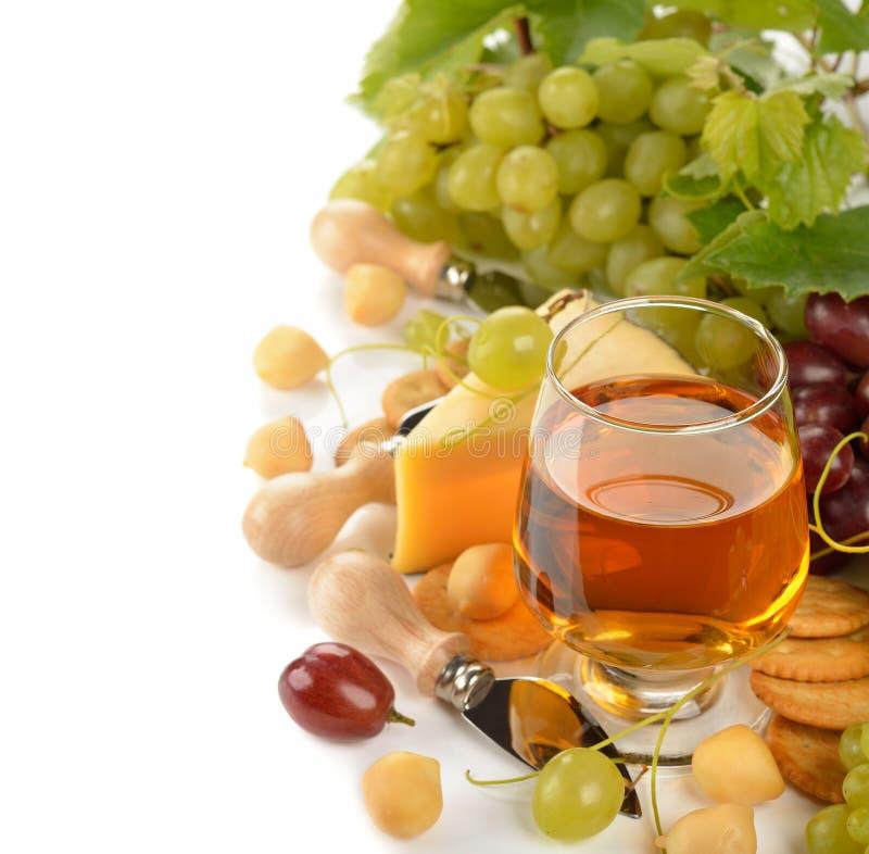 Wijn, druiven en kaas stock afbeelding