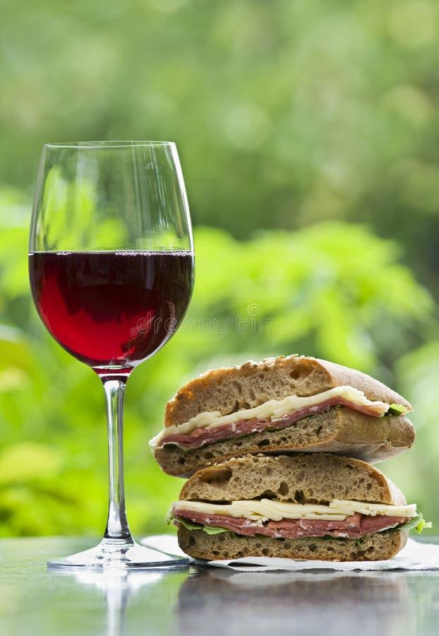 Wijn en sandwich stock fotografie