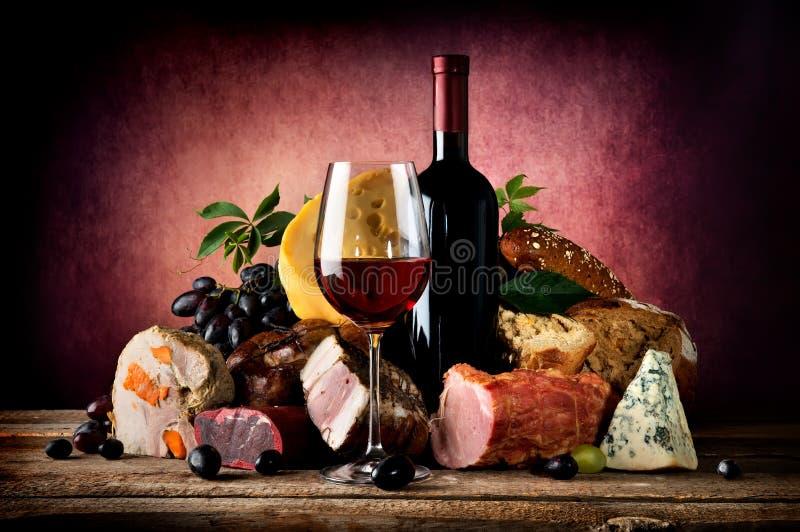 Wijn en voedsel stock fotografie