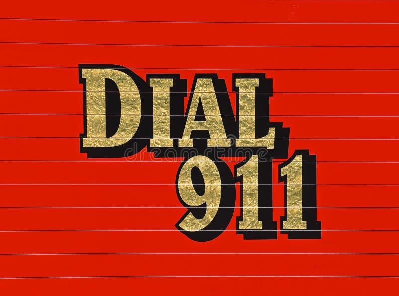 Wijzerplaat 911 op rode ziekenwagen royalty-vrije stock fotografie