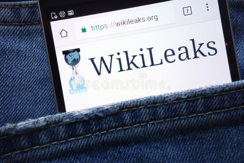 WikiLeaks website displayed on smartphone hidden in jeans pocket royalty free stock image