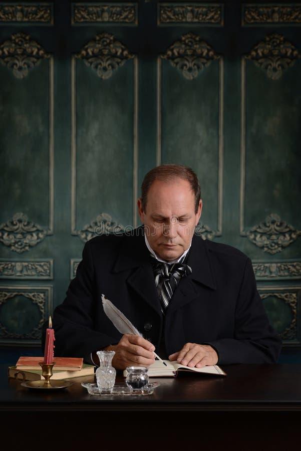 Wiktoriański urzędnika writing w jego księdze głównej fotografia stock