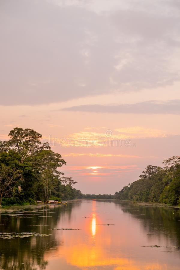 Wild angle shot of sunset above river at angkor wat temple area. Giand starus in the forceground royalty free stock photography
