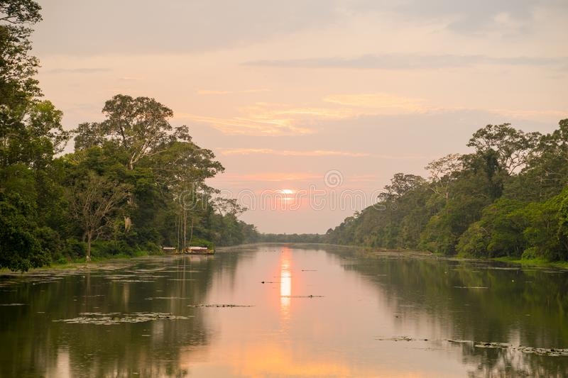 Wild angle shot of sunset above river at angkor wat temple area. Giand starus in the forceground stock photos