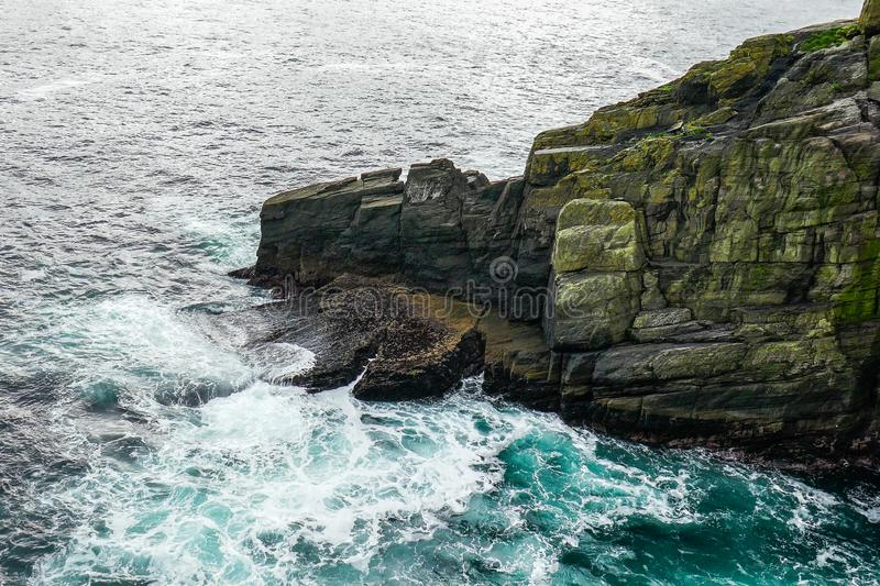 Wild Atlantic Way Ireland: Dramatic breaking waves crash onto Skellig Michael`s jagged rocks. Ireland`s desolate Skellig Michael Great Skellig Island rises royalty free stock photos