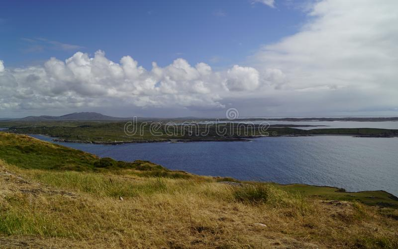 Wild Atlantik Way  Sky Road. Sky Road Bóthar na Spéire. The sky road is a scenic, circular drive, starting and ending in Clifden, the biggest town in royalty free stock images