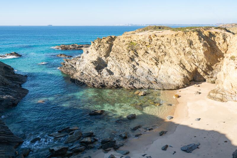 Wild beach in Costa Vicentina, Portugal. Wild beach in Costa Vicentina with Sines city on the foreground, Portugal stock image