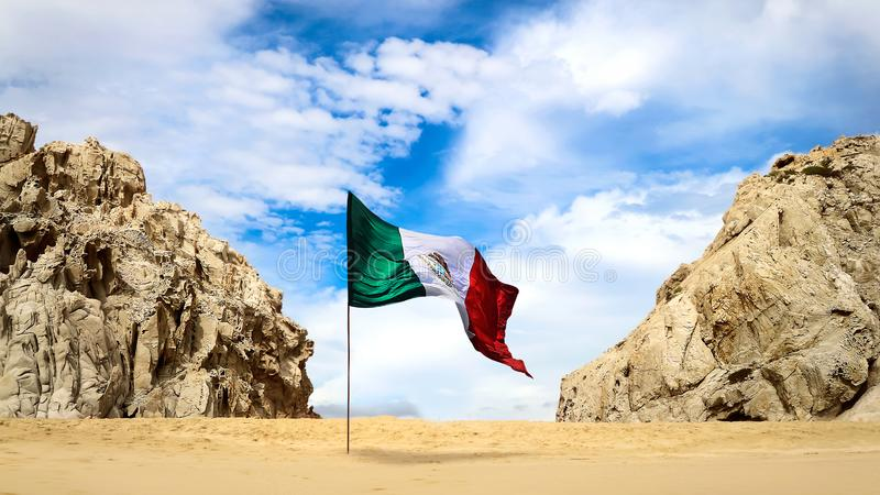 Wild beach in lower California of Mexico. Rocky formations on yellow sand against a blue sky with white clouds and Mexican flag. B. Aja California Sur. Cabo San stock photos